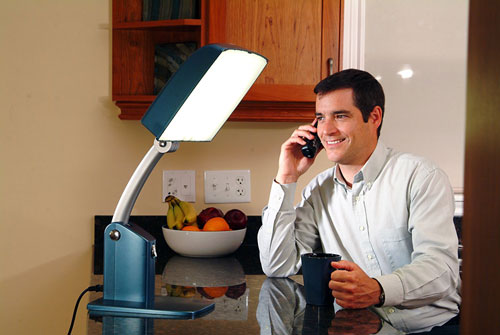 Man using Carex Health Brands Day Light-Sky on the phone
