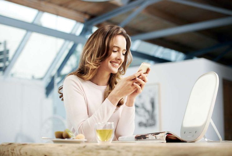 Philips HF3418 60 in use on desk by woman on phone